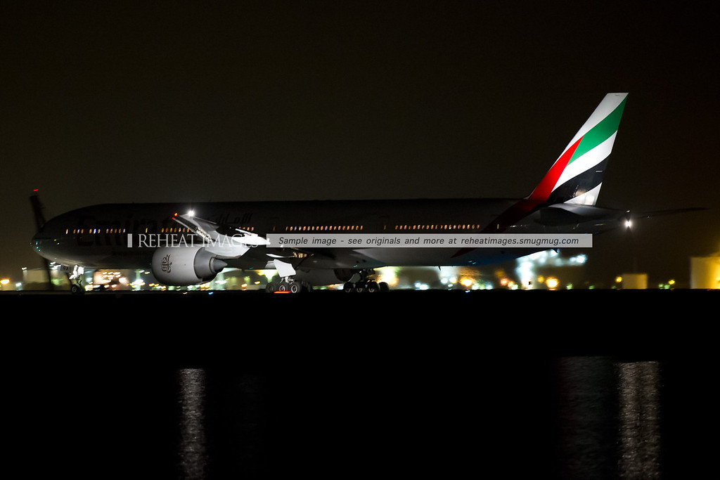 Emirates Boeing 777-300/ER A6-EGA heads out to the runway late on 1 January 2013. The plane then stopped and taxied across runway 34 left before heading back to the terminal. It is seen here taxiing across runway 34 left at Sydney airport.