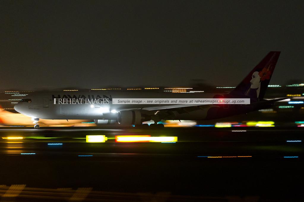 A Hawaiian Boeing 767-300/ER arrives in Sydney at night.