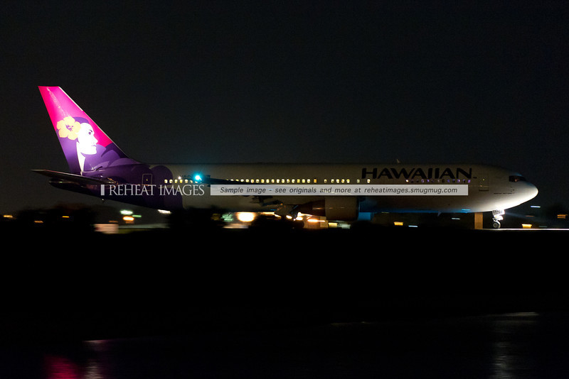 A Hawaiian Boeing 767-300/ER is taxiing out to runway 34 left at Sydney airport.
