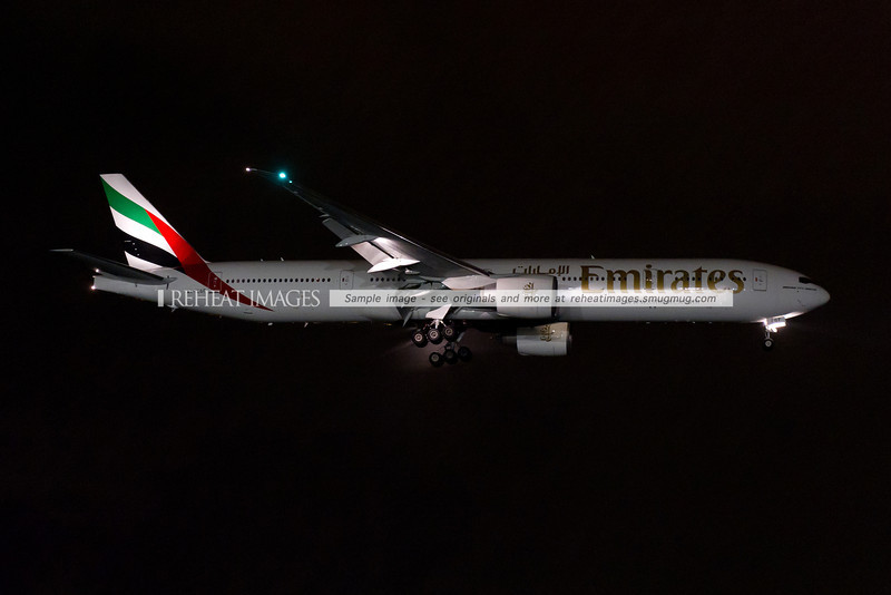 Emirates Boeing 777-300/ER A6-EGF on approach to Sydney airport at night, in moderate rain. This is one of the newer Emirates B777 aircraft.