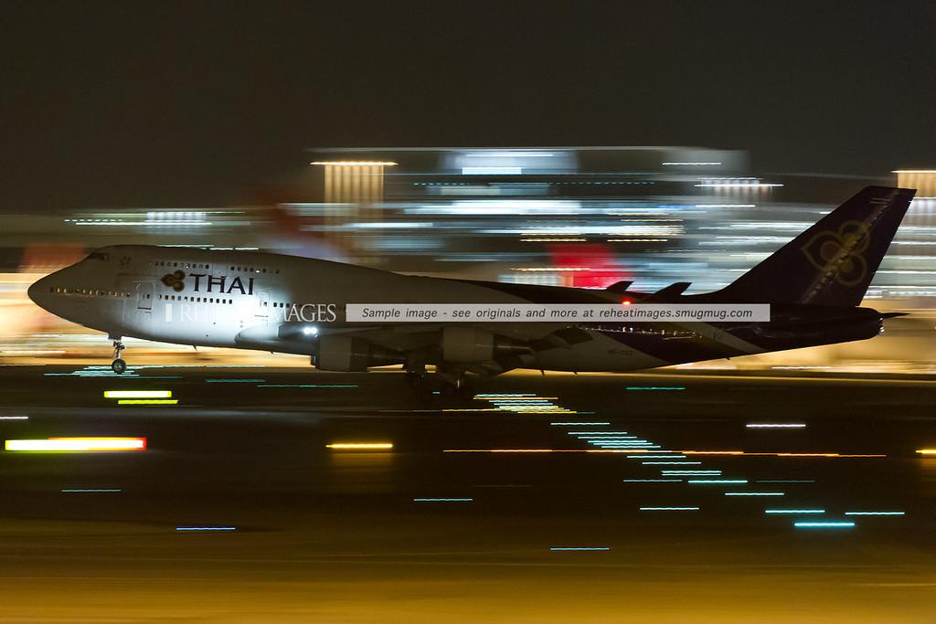 Thai Boeing 747-400 arrives in Sydney at night.