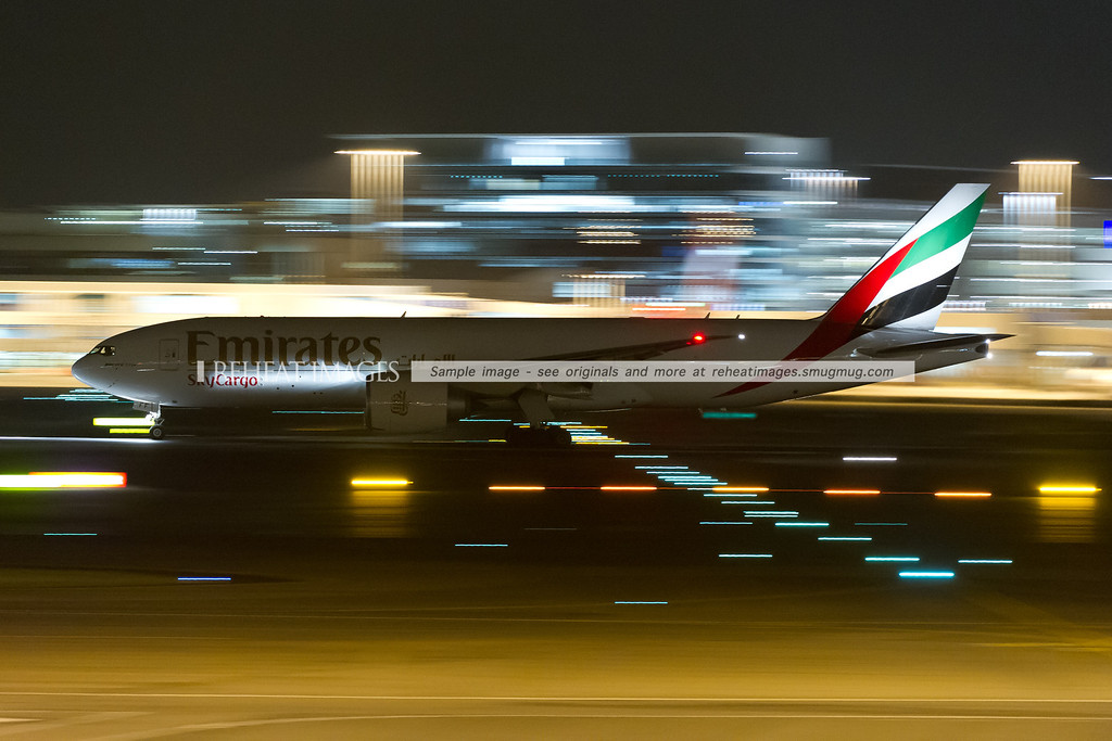 Emirates SkyCargo B777-F1H takes off from Sydney airport.