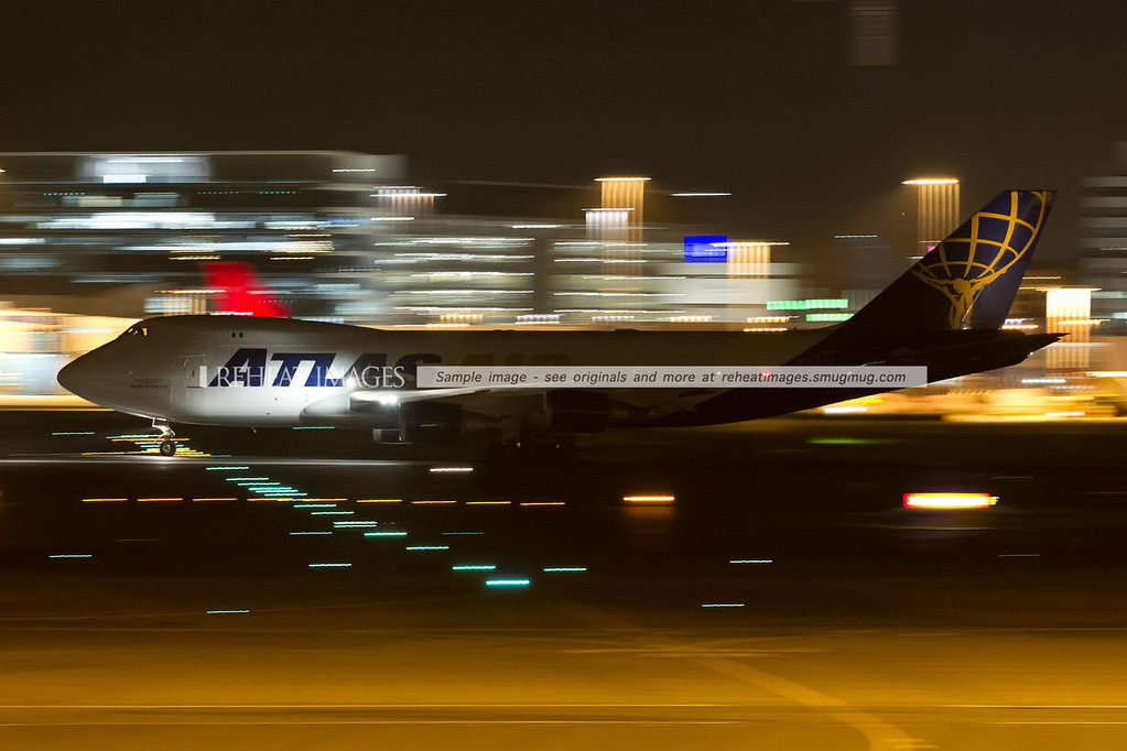 Qantas Freight (operated by Atlas Air) departs Sydney airport at night.