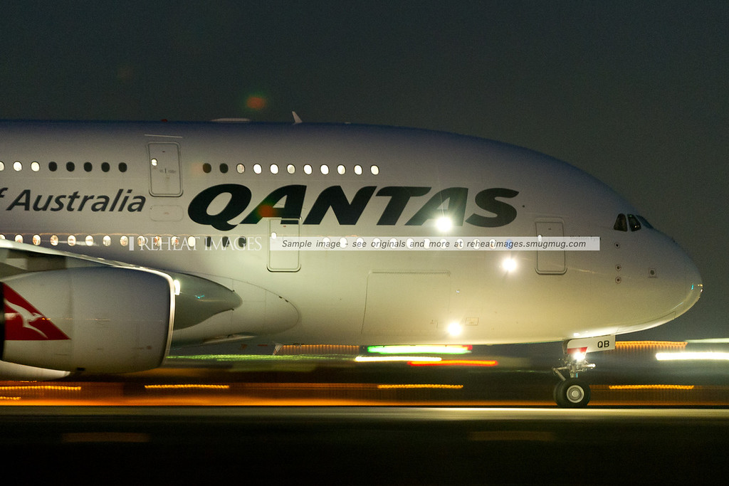 A Qantas Airbus A380-842 super-jumbo heads out to runway 34 left, where it will depart Sydney, headed for Singapore in darkness. QF31 here was delayed along with many other flights that day from almost all other airlines. It is captured here with ISO8000 and 1/4 second shutter speed.