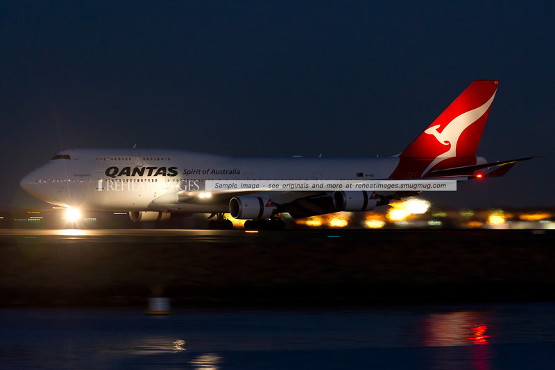 Qantas' B747-438/ER VH-OEG is now in the revised Qantas colours. It is seen here completing its landing after a very long flight from Buenos Aires.