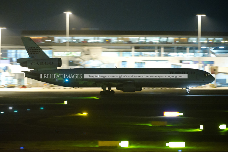Etihad 9876 arrived late at night, operated by this World Airways McDonnell-Douglas MD-11F.