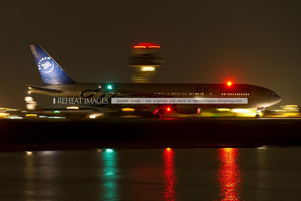 Korean Airlines SkyTeam logo-jet leaves Sydney under the cover of darkness.