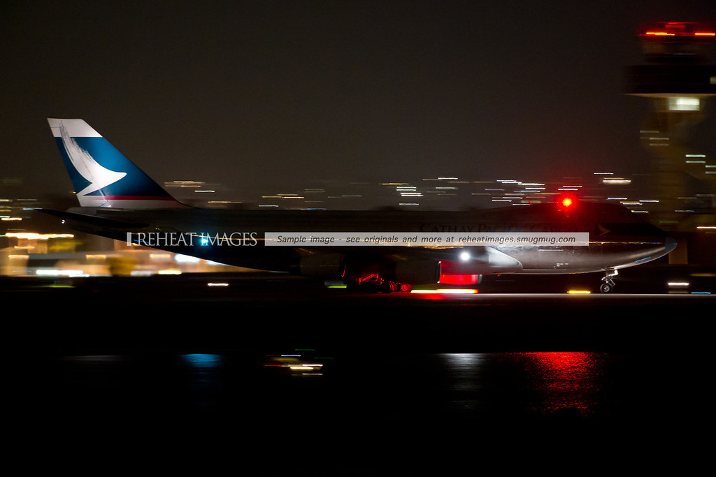 Cathay Pacific Cargo 'silver bullet' B747-400F departs Sydney at night, headed for Hong Kong. This plane is finished as polished metal - rather than being painted. It is an eye-catching look.