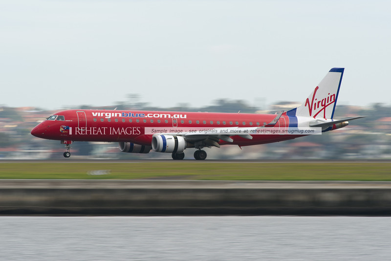 Virgin Blue liveried Embraer E Jet lands at Sydney airport.