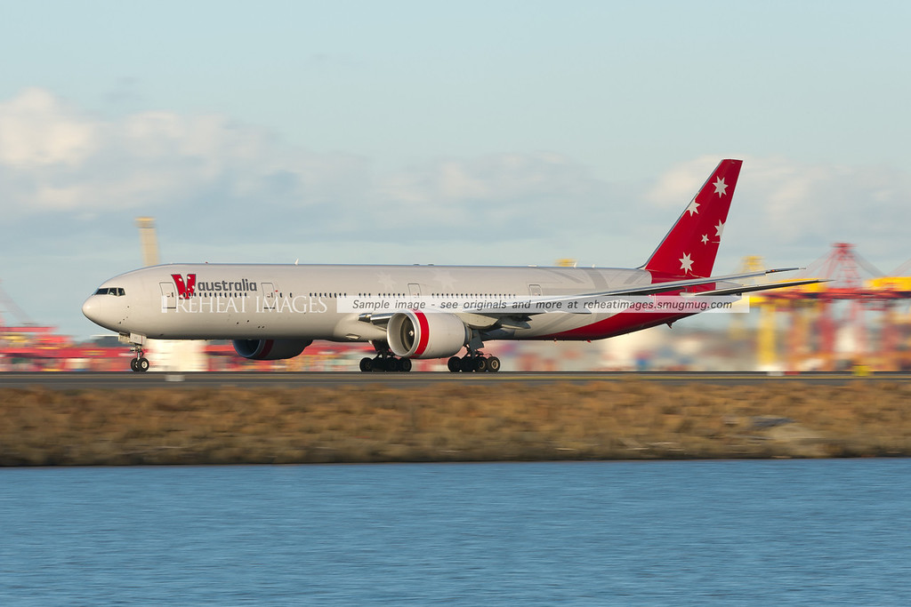 A V.Australia Boeing 777-3ZG/ER takes off from Sydney airport, headed for Abu Dhabi.