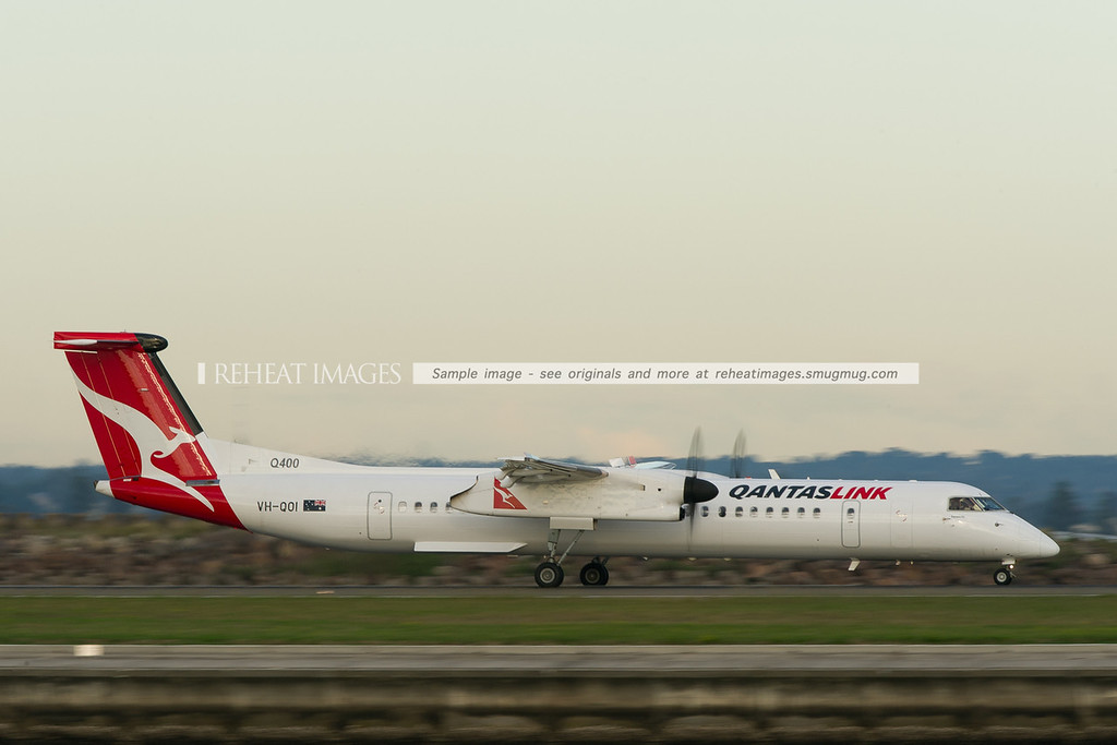 A QantasLink Bombardier Dash-8 Q400 takes off from runway 34 right at Sydney airport.