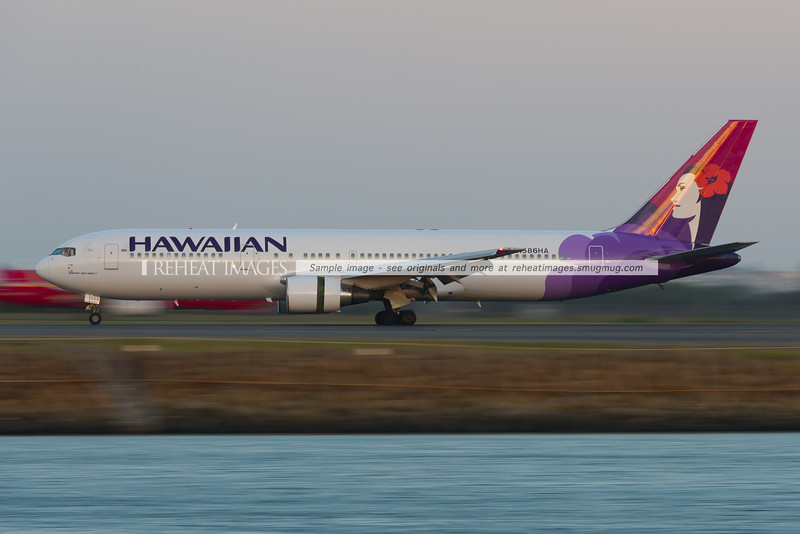 Hawaiian Boeing 767 seen at dusk in Sydney airport.