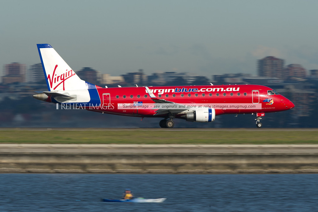 Virgin Blue Embraer E-Jet takes off from runway 34 right at Sydney airport.