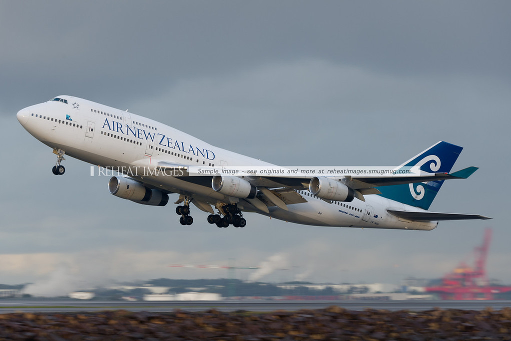 Air New Zealand B747-400 taking off from Sydney airport in poor weather conditions.