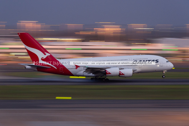 A Qantas A380-842 lands in Sydney at dusk as QF32 from London via Singapore.