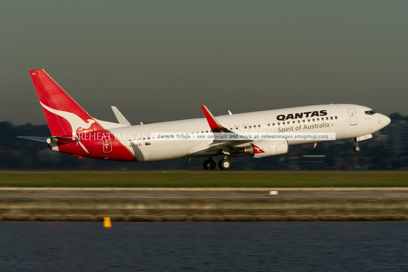A Qantas Boeing 737-838 takes off from Sydney airport runway 34 right.
