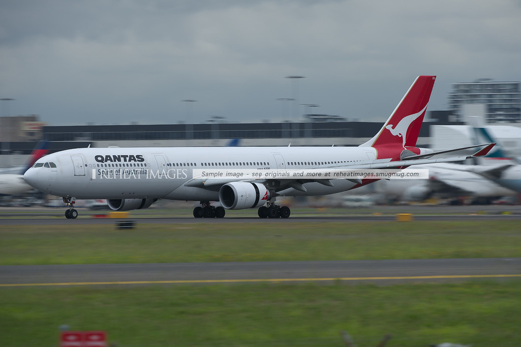 A Qantas Airbus A330-300 slows down after landing on runway 16 right at Sydney airport.