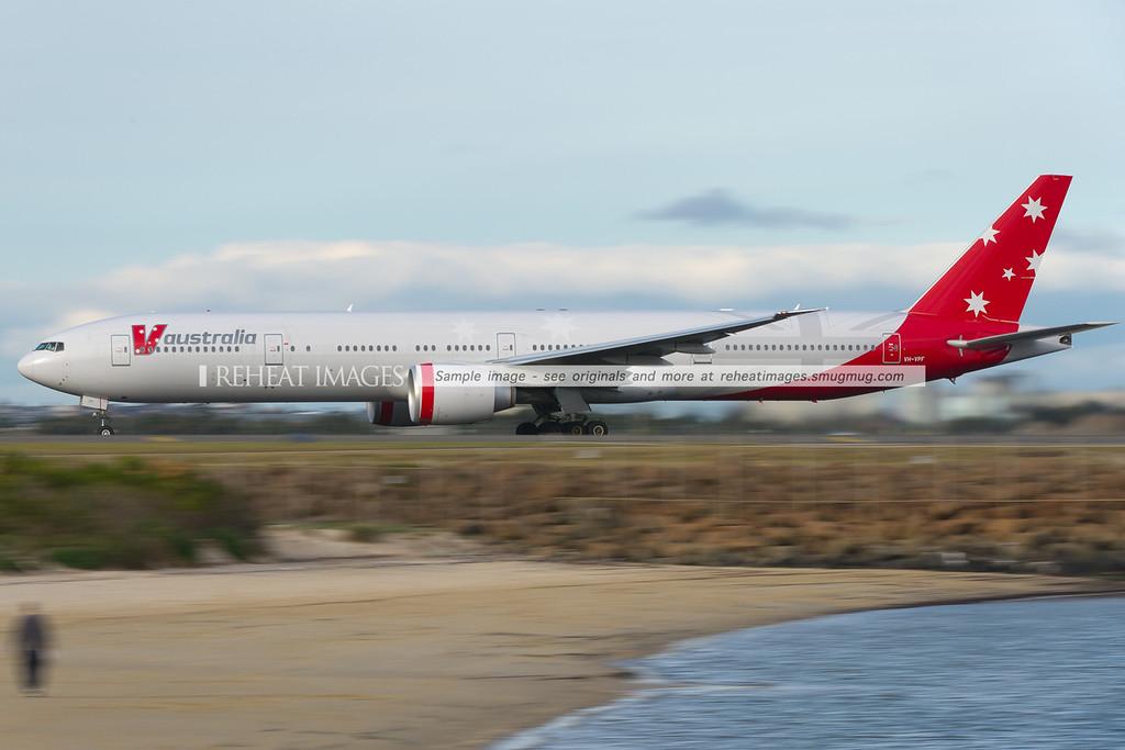 V Australia B777-300/ER leaves Sydney airport, headed for Abu-Dhabi.