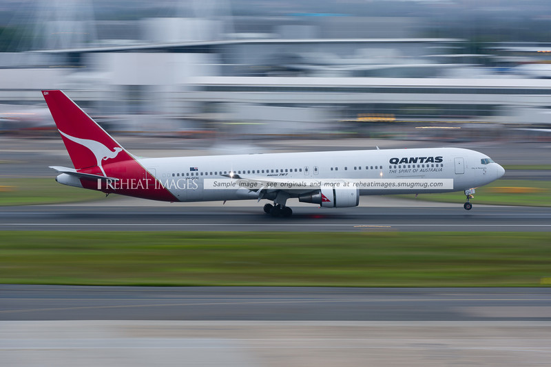 A Qantas B767-338/ER lands at Sydney airport.