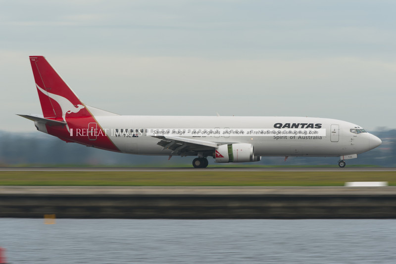 A Qantas B737-400 slows down after landing at Sydney airport.