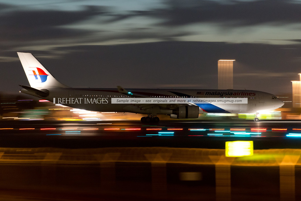 Malaysia Airlines Airbus A330 9M-MTB arrives in Sydney at night.