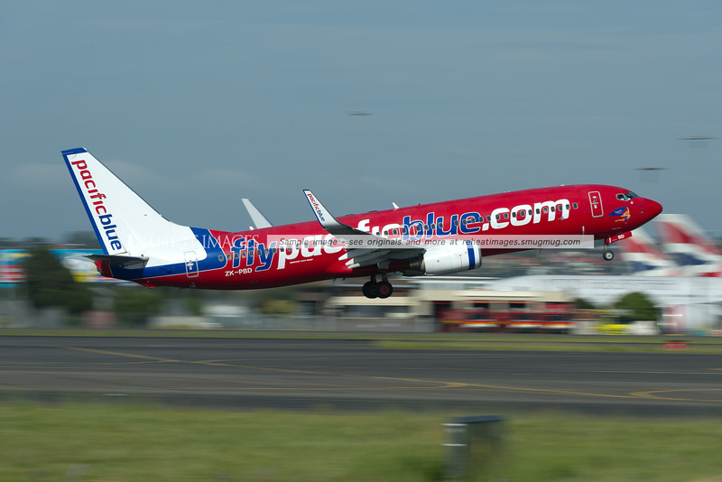 A Pacific Blue Boeing 737-800 lifts off from runway 34 left at Sydney airport.