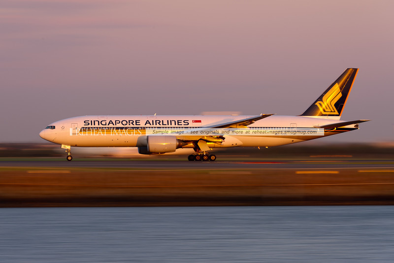 Singapore Airlines B777-212/ER departs Sydney airport at sunset, its speed highlighted by the 1/10sec shutter speed.