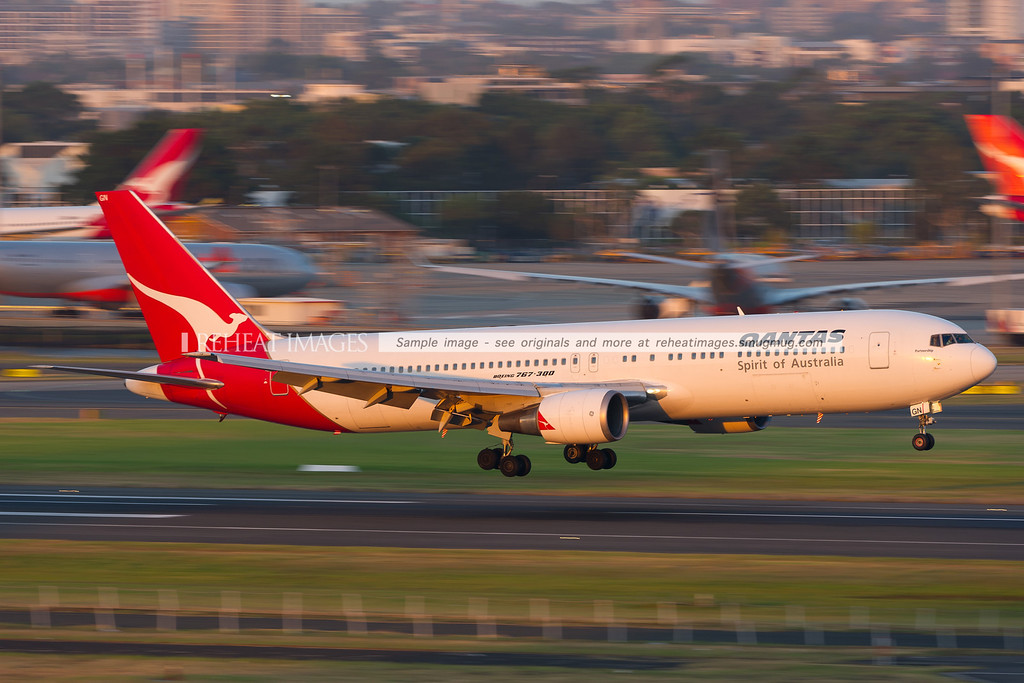 A Qantas B767-338/ER lands on runway 16 right at Sydney airport.