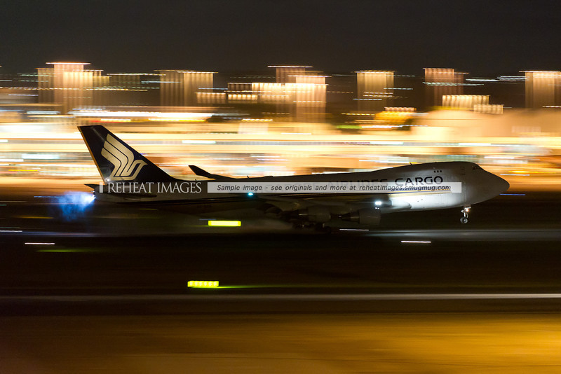 Singapore Airlines Cargo Boeing 747-400 Freighter lands in Sydney Airport at night.