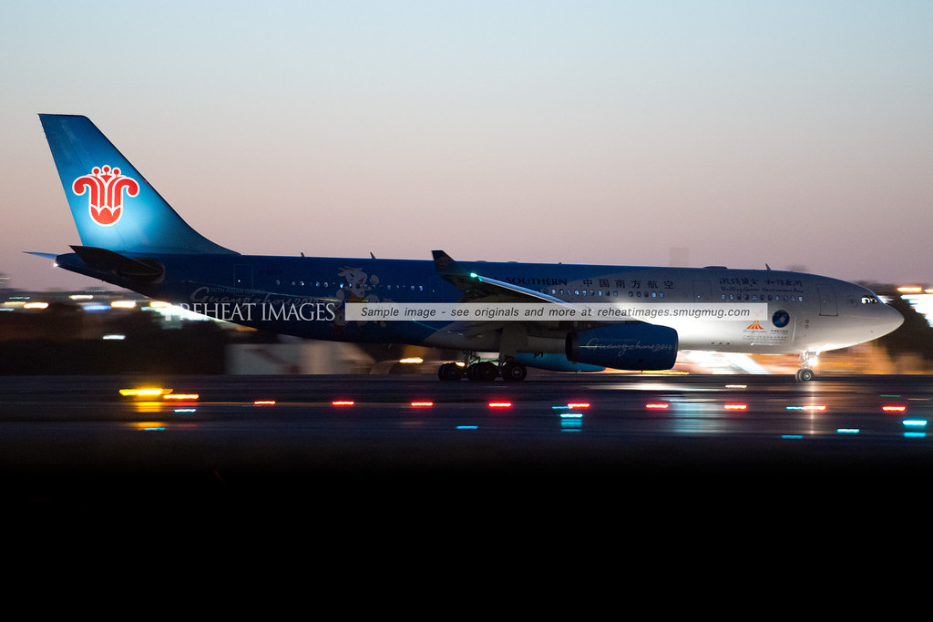 China Southern Guangzhou 2010 themed Airbus A330 lands at Sydney airport at dusk.