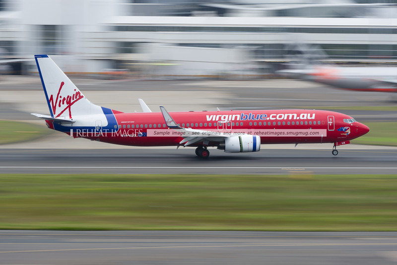 A Virgin Blue (Virgin Australia) B737-800 lands at Sydney airport.