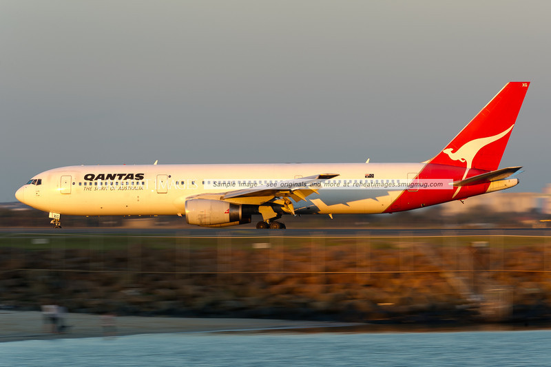 A Qantas B767-336/ER lands at Sydney airport.