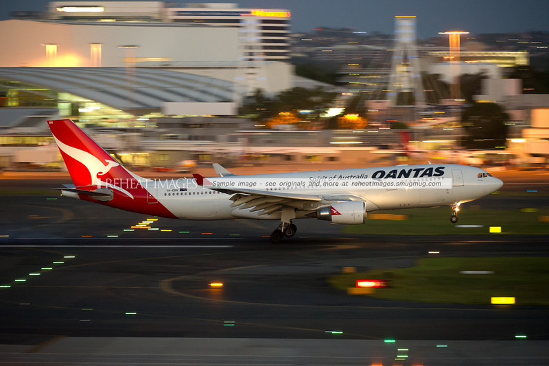 A Qantas Airbus A330-202 lands at Sydney airport on runway 16 right.