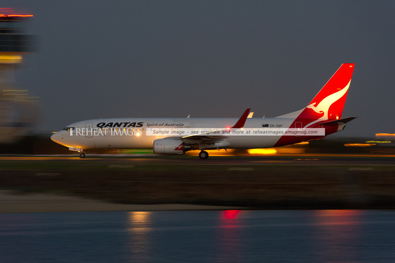 JetConnect B737-800 ZK-ZQF arrives in Sydney after its go-around. The plane no longer wears special colours for the Rugby World Cup 2011, as can be seen by the lighter white batches in the shape of the decals that were applied to the plane.