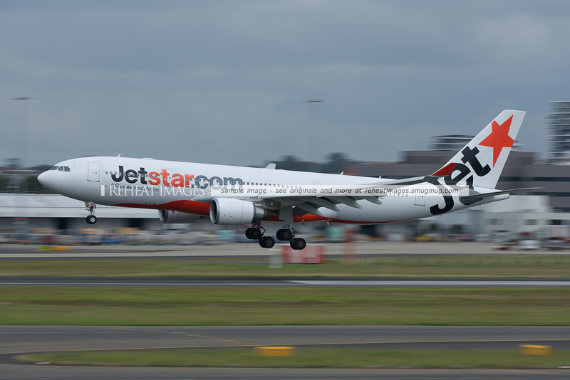 The only white Jetstar A330 Airbus lands on runway 16 right at Sydney airport.