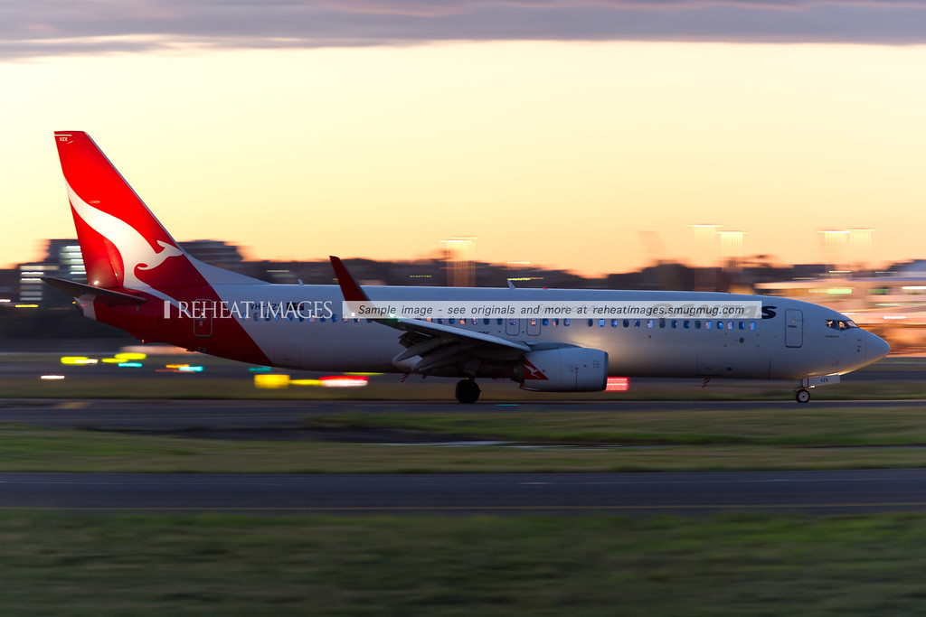 Qantas Boeing 737-838 taxiing at dusk