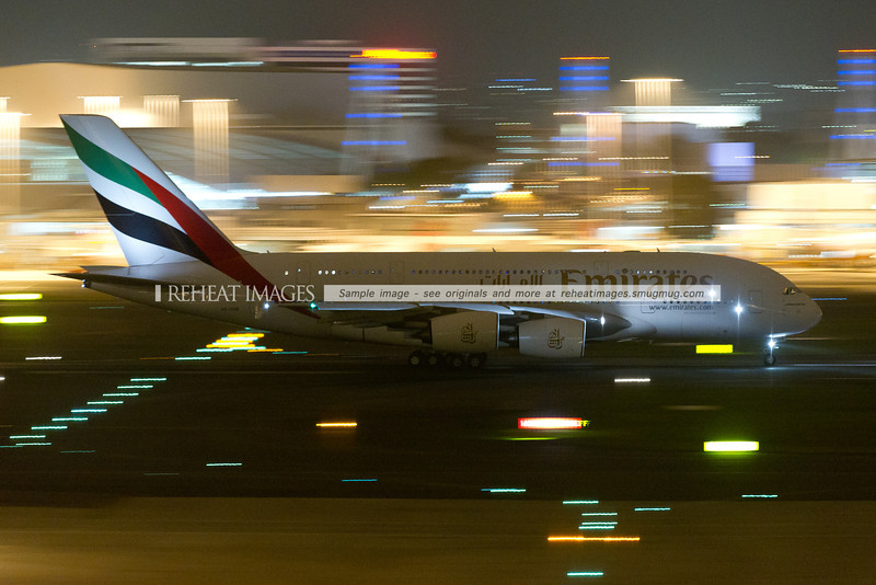 Emirates second Airbus A380-861 departs Sydney airport at night.