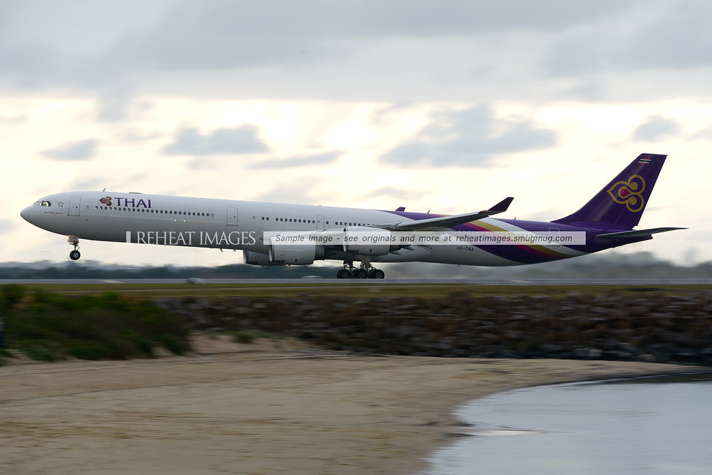 Thai Airbus A340-600 takes off from Sydney airport during a temporary rain shower.