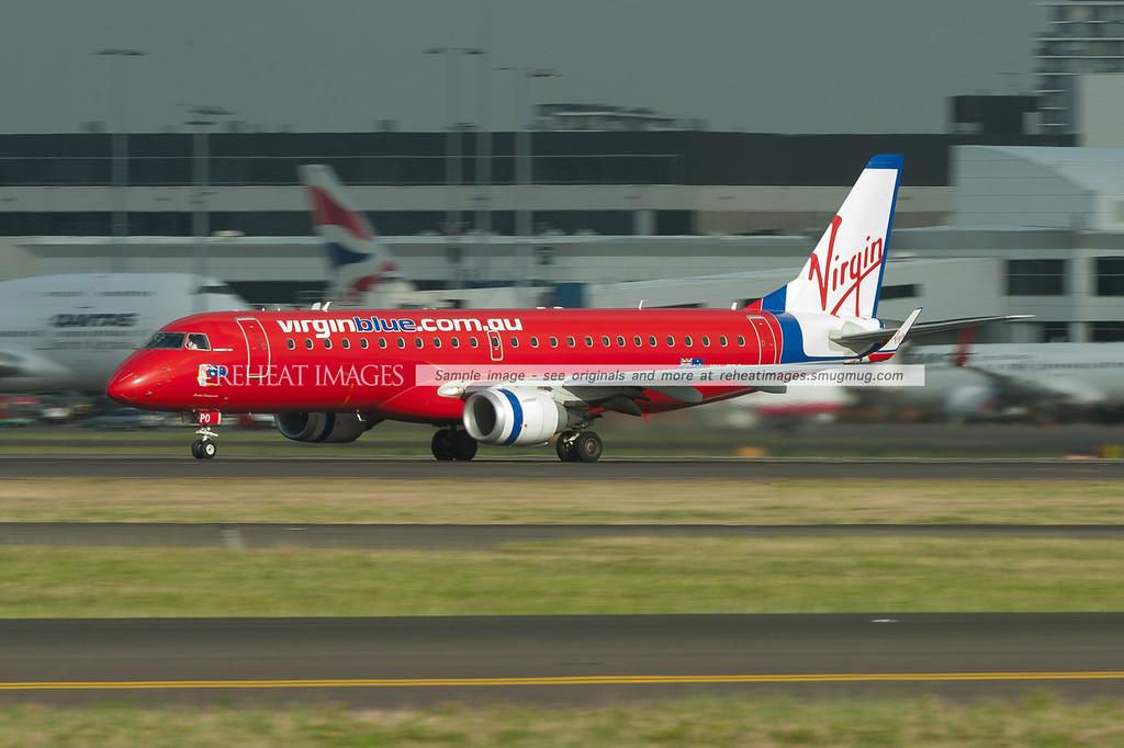Virgin Blue (Virgin Australia) Embraer E190 takes off from runway 16 right at Sydney airport.