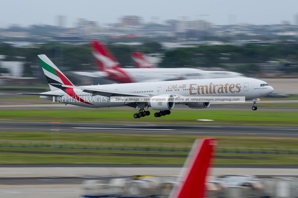 Emirates B777-300/ER lands at Sydney airport.