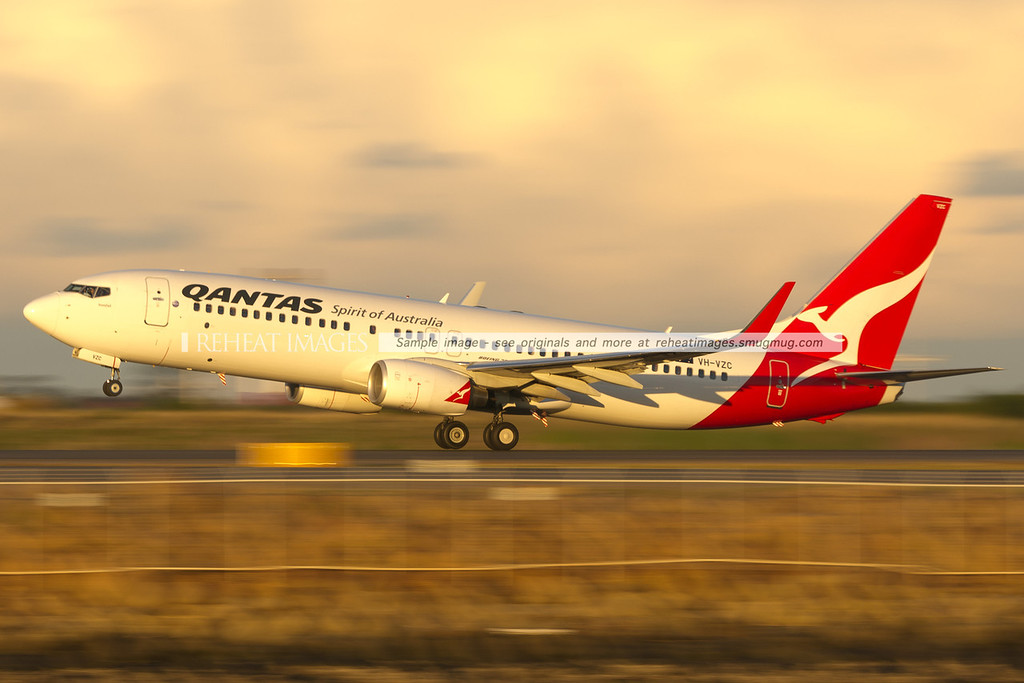 Qantas Boeing 737-800 taking off from Sydney airport. Low shutter speed panning effects are used here.