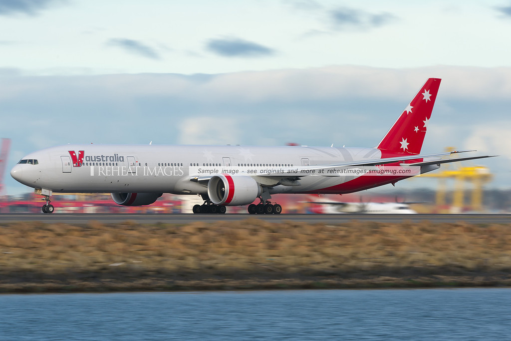 V Australia B777-300/ER leaves Sydney airport, headed for Abu-Dhabi.
