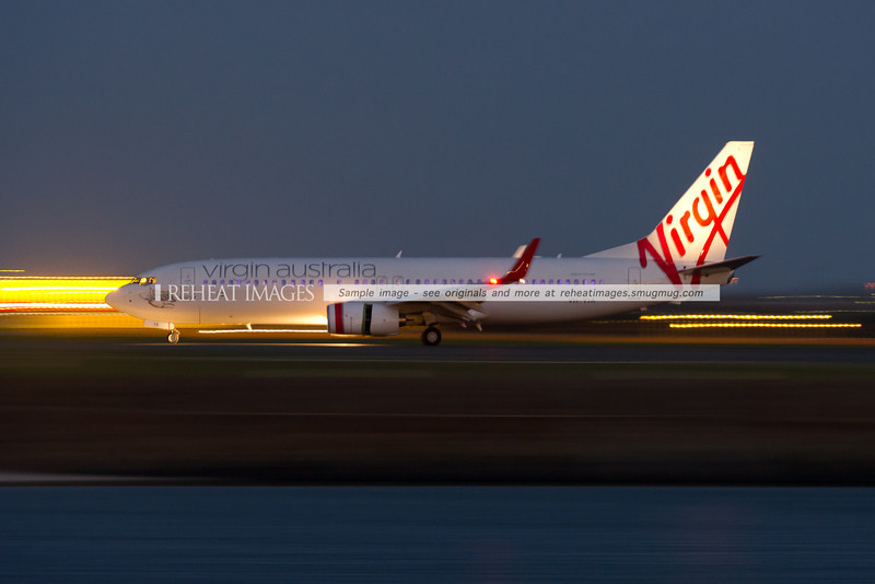 "A Virgin Australia Boeing 737-800 with the very obvious ""Sky Interior"" arrives in Sydney at night."