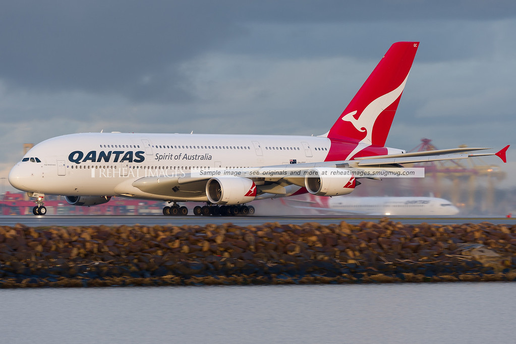 A Qantas Airbus A380-842 takes off from Sydney airport. A Qantas B737-838 is seen in the background.