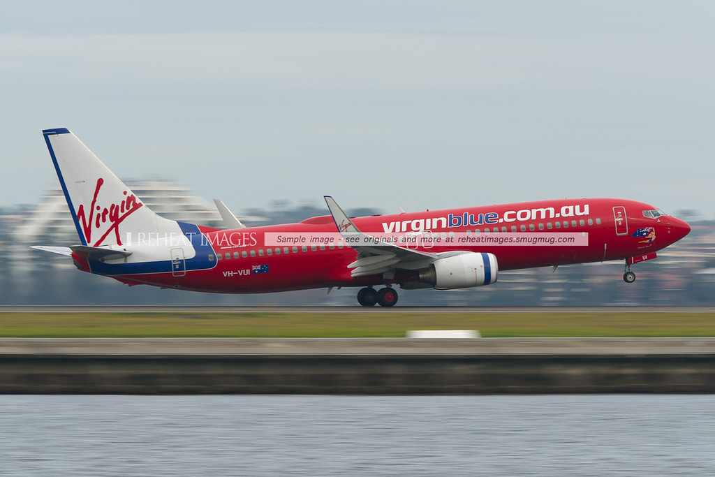 A Virgin Blue B737-800 takes off from Sydney airport.
