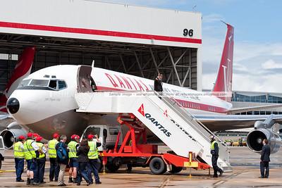 John Travolta waves for the media at the Qantas 90th anniversary celebrations in Sydney.