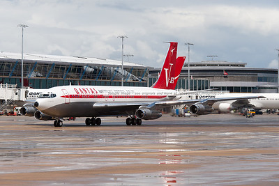 John Travolta arrives at the Qantas 90th anniversary celebrations in Sydney with his 1964 Qantas Boeing 707-138B.