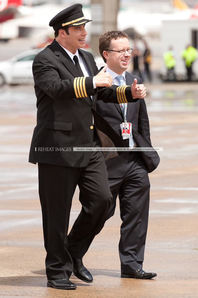 John Travolta and Qantas' Alan Joyce at the Qantas 90th anniversary celebrations in Sydney. Mr Travolta gives the thumbs up!