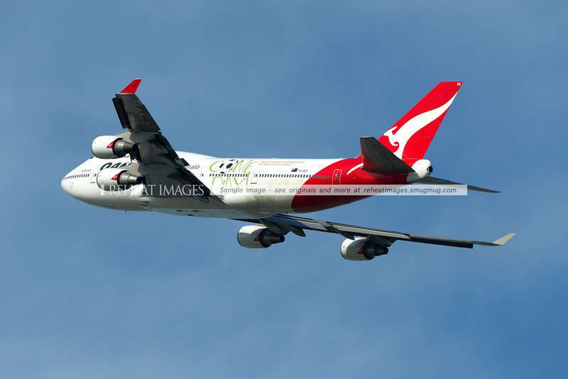 "Qantas' Boeing 747-48E (formerly from Asiana Airlines) takes off from runway 34 left at Sydney Airport on a short flight to Avalon. The plane would likely reach 40,000ft on this short flight. The plane is seen here wearing a special colour scheme ""Come Play' indicating Qantas' support for the failed Australian Football World Cup bid. This plane also wore the large ""OneWorld"" titles for a time, and was the first Qantas Boeing 747 to receive the new logotype and revised kangaroo logo on the tail."
