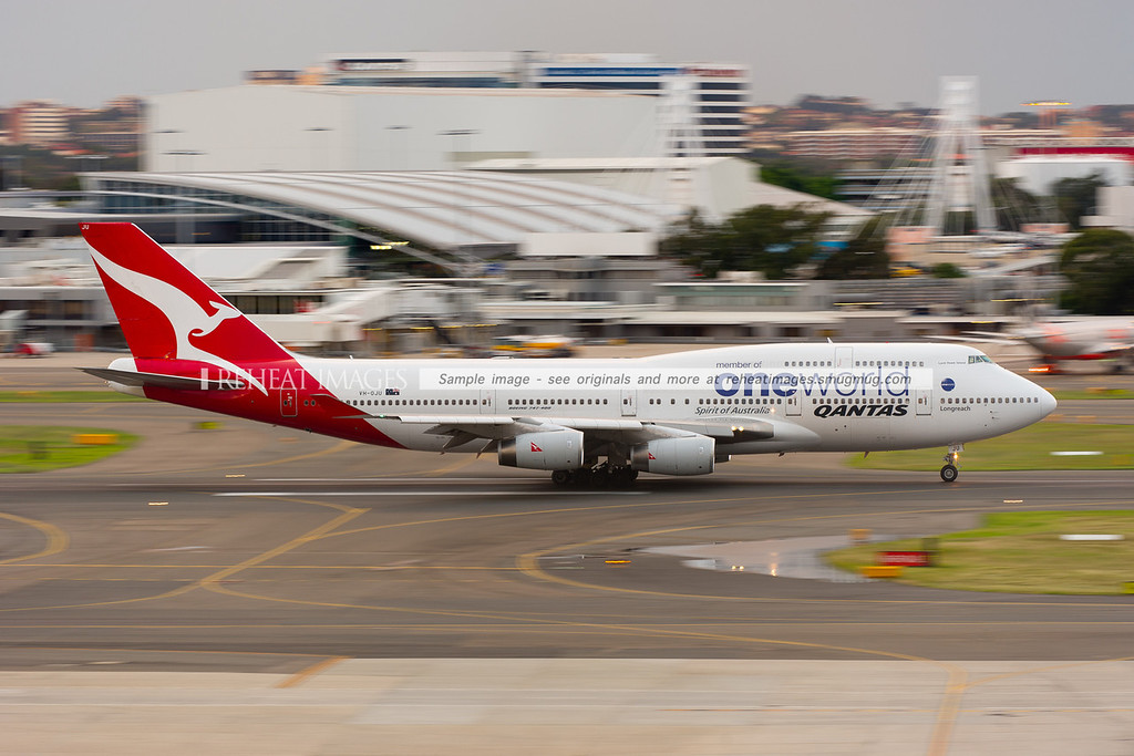 A Qantas Boeing 747-438 in OneWorld alliance colour scheme leaves Sydney Airport.